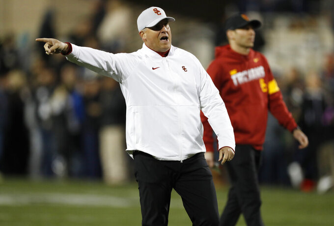 Southern California coach Clay Helton gestures during the team's NCAA college football game against Colorado on Friday, Oct. 25, 2019, in Boulder, Colo. (AP Photo/David Zalubowski)