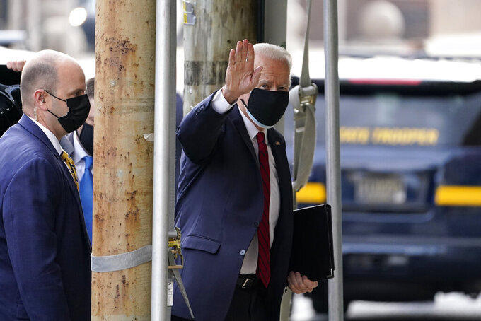 President-elect Joe Biden waves as he arrives at The Queen theater, Friday, Jan. 15, 2021, in Wilmington, Del. (AP Photo/Matt Slocum)
