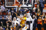 Iowa State guard Rasir Bolton, center, loses the ball between Oklahoma State forward Yor Anei, left, and guard Avery Anderson III (0) in the first half of an NCAA college basketball game in Stillwater, Okla., Saturday, Feb. 29, 2020. (AP Photo/Sue Ogrocki)