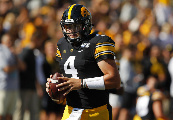 Iowa quarterback Nate Stanley warms up before the first half of an NCAA college football game against Rutgers, Saturday, Sept. 7, 2019, in Iowa City. (AP Photo/Matthew Putney)