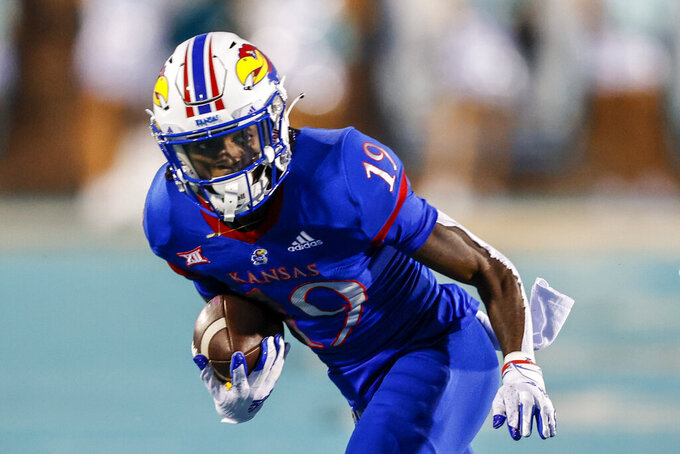 Kansas wide receiver Steven McBride runs after a catch against Coastal Carolina during the first half of an NCAA college football game in Conway, S.C., Friday, Sept. 10, 2021. (AP Photo/Nell Redmond)