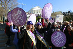 Equal Rights Amendment supporters demonstrate outside Virginia State Capitol in Richmond, Va., Wednesday, Jan. 8, 2020. The 2020 session of the Virginia Legislature begins Wednesday. (AP Photo/Steve Helber)