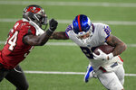 New York Giants' Evan Engram, right, fends off Tampa Bay Buccaneers' Lavonte David during the first half of an NFL football game, Monday, Nov. 2, 2020, in East Rutherford, N.J. (AP Photo/Bill Kostroun)