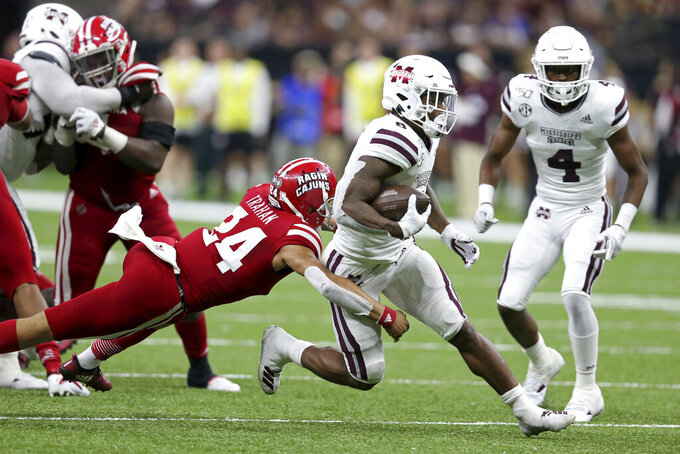 Mississippi State running back Kylin Hill (8) is tackled by Louisiana-Lafayette defensive back Bralen Trahan (24) in the second quarter of an NCAA college football game in New Orleans, Saturday, Aug. 31, 2019. (AP Photo/Chuck Cook)