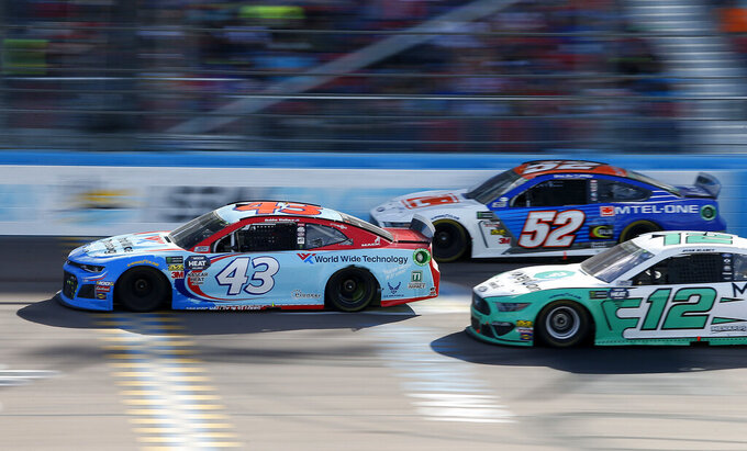 Bubba Wallace (43), Bayley Currey (52) and Ryan Blaney (12) race through Turn 4 during the NASCAR Cup Series auto race at ISM Raceway, Sunday, March 10, 2019, in Avondale, Ariz. (AP Photo/Ralph Freso)
