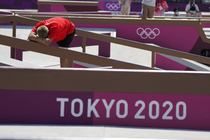 Angelo Caro Narvaez of Peru reacts after finishing fifth in the men's street skateboarding finals at the 2020 Summer Olympics, Sunday, July 25, 2021, in Tokyo, Japan. (AP Photo/Ben Curtis)