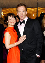 """FILE - Actor Damian Lewis and wife Helen McCrory arrives at the Metropolitan Museum of Art Costume Institute gala benefit, celebrating Elsa Schiaparelli and Miuccia Prada,in New York on May 7, 2012. McCrory, who starred in the television show """"Peaky Blinders"""" and the """"Harry Potter"""" movies, has died. She was 52 and had been suffering from cancer. Her husband, actor Damian Lewis, said Friday that McCrory died """"peacefully at home"""" after a """"heroic battle with cancer."""" (AP Photo/Evan Agostini, File)"""