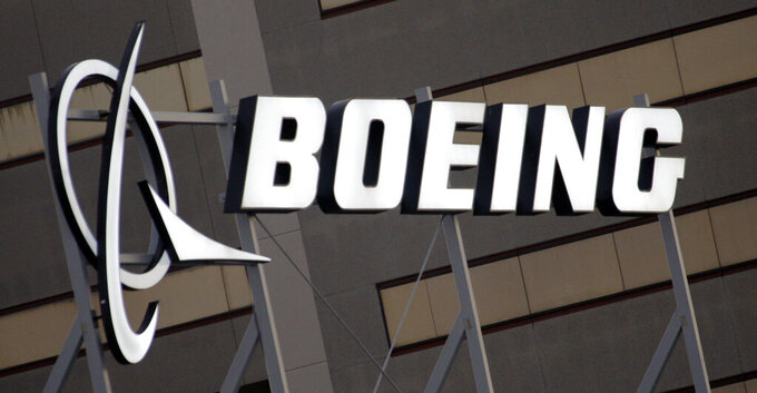 FILE - In this Jan. 25, 2011 file photo, the Boeing Company logo on the property in El Segundo, Calif. Russian media report that a Boeing 777 plane made an emergency landing in Moscow in the early hours of Friday Feb. 26, 2021, after the pilot reported a problem with the engine. (AP Photo/Reed Saxon, File)