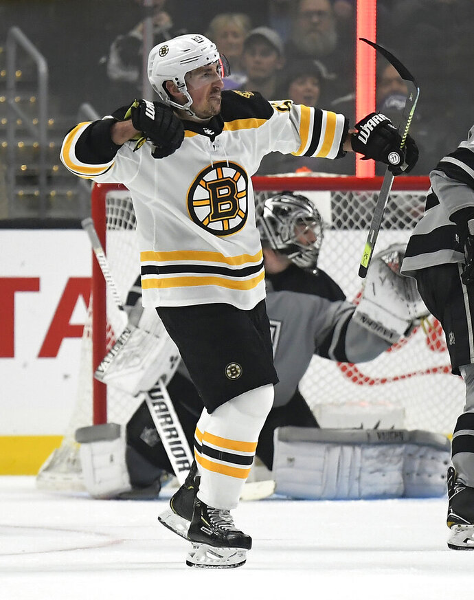 Boston Bruins left wing Brad Marchand, left, celebrates after scoring on Los Angeles Kings goaltender Jack Campbell during the second period of an NHL hockey game Saturday, Feb. 16, 2019, in Los Angeles. (AP Photo/Mark J. Terrill)