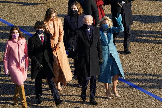 President Joe Biden and his wife Jill Biden walk in a parade during the Presidential Escort, part of Inauguration Day ceremonies, Wednesday, Jan. 20, 2021, in Washington. (AP Photo/David J. Phillip)