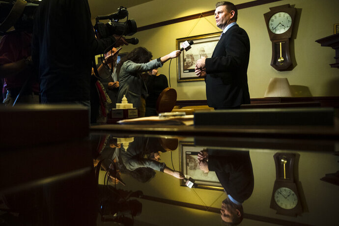 Sen. John Yudichak of Luzerne County speaks with members of the media at the Pennsylvania Capitol in Harrisburg, Pa., Tuesday, Nov. 19, 2019. The Democrat in Pennsylvania's state Senate from an area that shifted decisively to support Donald Trump in 2016's presidential election is switching his registration to become an independent and will caucus with the Republican majority. (AP Photo/Matt Rourke)