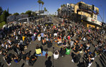 Protesters stage a sit-in in front of the Laugh Factory comedy club, Tuesday, June 9, 2020, in the Hollywood section of Los Angeles over the death of George Floyd. Floyd, a black man died after being restrained by Minneapolis police officers on May 25. (AP Photo/Mark J. Terrill)