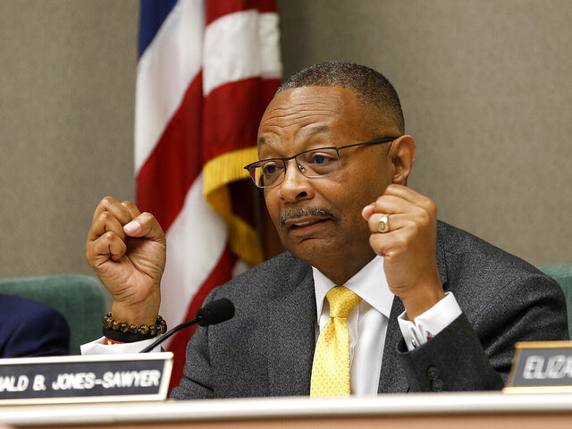FILE - In this April 9, 2019 file photo, Assemblyman Reginald Jones-Sawyer, D-Los Angeles, chairman of the Assembly Public Safety Committee, discusses legislation to restrict the use of deadly force by police, during a hearing on the measure in Sacramento, Calif. The California Correctional Peace Officers Association literally put a target on Democratic Assemblyman Reggie Jones-Sawyer of Los Angeles in a 59th Assembly District campaign ad the union quickly withdrew admit criticism. As chairman of the Assembly Public Safety Committee, Jones-Sawyer has promoted policies to reduce mass incarceration. (AP Photo/Rich Pedroncelli, File)