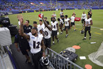 Baltimore Ravens' Rashad Bateman (120 waves to fans after practice at NFL football training camp Saturday, July 31, 2021, in Baltimore. (AP Photo/Gail Burton)