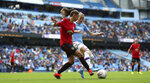 Manchester City's Janine Beckie, right, and Manchester United's Abbie McManus battle for the ball during the Women's Super League soccer match at the Etihad Stadium, Manchester, England, Saturday Sept. 7, 2019. (Nigel French/PA via AP)