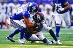 New York Giants inside linebacker Blake Martinez (54) tackles Denver Broncos' K.J. Hamler (1) during the first half of an NFL football game Sunday, Sept. 12, 2021, in East Rutherford, N.J. (AP Photo/Matt Rourke)