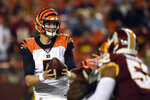 Cincinnati Bengals quarterback Ryan Finley (5) looks for a receiver under pressure from Washington Redskins linebacker Ryan Anderson (52) during the first quarter of an NFL preseason football game in Landover, Md., Thursday, Aug. 15, 2019. (AP Photo/Susan Walsh)