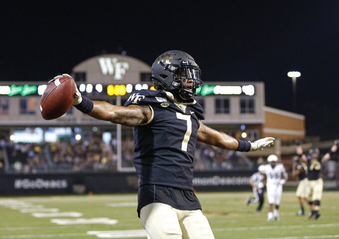 Wake Forest wide receiver Scotty Washington celebrates after catching a touchdown pass against Utah State in the first half of an NCAA college football game in Winston-Salem, N.C., Friday, Aug. 30, 2019. (AP Photo/Nell Redmond)