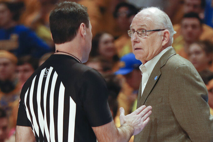 Miami head coach Jim Larrañaga, right, talks with an official during the first half of an NCAA college basketball game against Pittsburgh, Sunday, Feb. 2, 2020, in Pittsburgh. (AP Photo/Keith Srakocic)