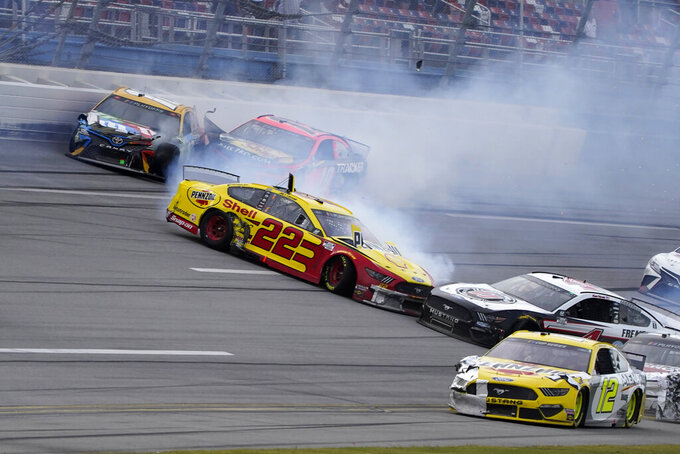 Kyle Busch (18), Martin Truex Jr., Joey Lagano (22) and Kevin Harvick (4) wreck during the NASCAR Cup Series auto race at Talladega Superspeedway on Sunday, Oct. 4, 2020, in Talladega, Ala. (AP Photo/John Bazemore)