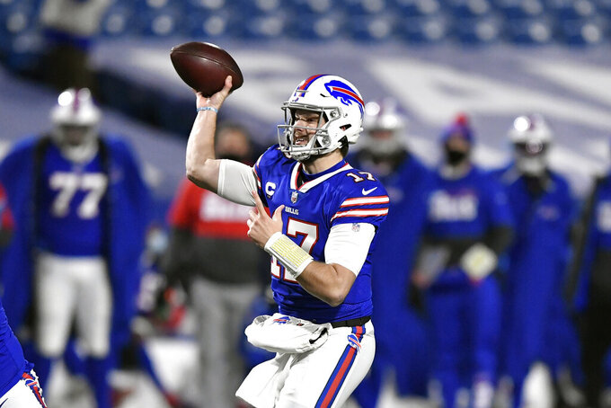 Buffalo Bills quarterback Josh Allen (17) throws a pass during the first half of an NFL divisional round football game against the Baltimore Ravens Saturday, Jan. 16, 2021, in Orchard Park, N.Y. (AP Photo/Adrian Kraus)
