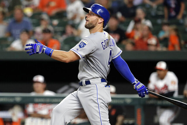 FILE - In this Aug. 20, 2019, file photo, Kansas City Royals' Alex Gordon follows through on a swing during the third inning of a baseball game against the Baltimore Orioles in Baltimore. Alex Gordon has agreed to consent to a trade by the Kansas City Royals starting June 16, an unusual provision in the outfielder's new $4 million, one-year contract. (AP Photo/Julio Cortez, File)