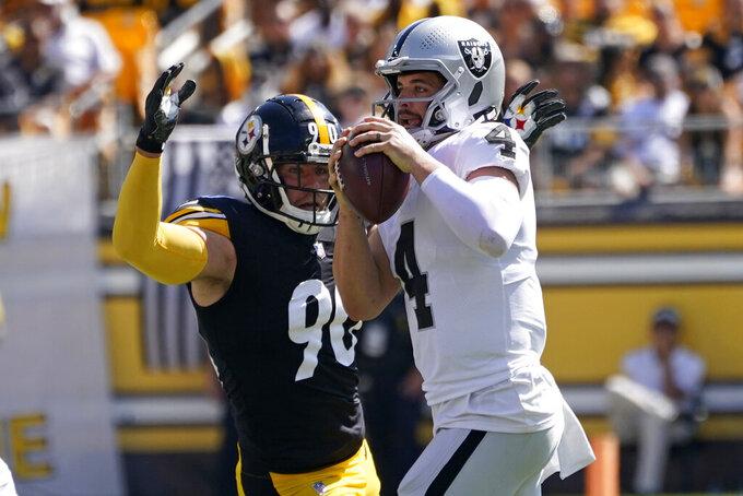 Pittsburgh Steelers outside linebacker T.J. Watt (90) pressures Las Vegas Raiders quarterback Derek Carr (4) during the first half of an NFL football game in Pittsburgh, Sunday, Sept. 19, 2021. (AP Photo/Keith Srakocic)