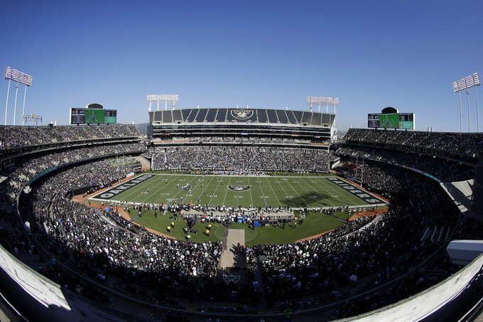 FILE - This Nov. 3, 2019, file photo, shows a general view of RingCentral Coliseum during the first half of an NFL football game between the Oakland Raiders and the Detroit Lions in Oakland, Calif. The Raiders' final scheduled game in Oakland on Sunday, Dec. 15, 2019, will be an emotional one for players and coaches, as well as fans. (AP Photo/Jeff Chiu, File)