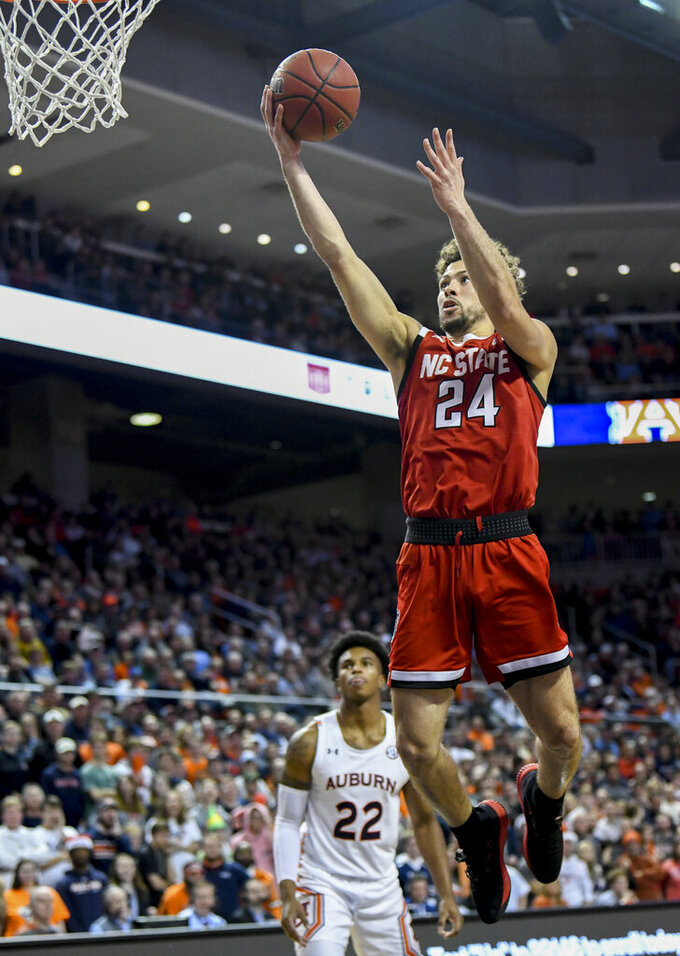 North Carolina State guard Devon Daniels (24) scores against Auburn during the first half of an NCAA college basketball game Thursday, Dec. 19, 2019, in Auburn, Ala. (AP Photo/Julie Bennett)