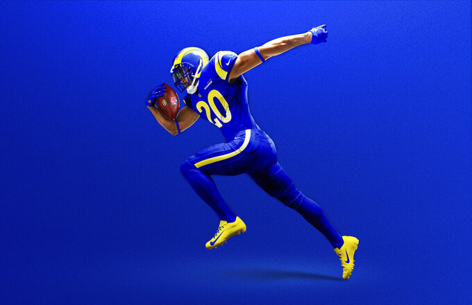 This undated graphic image released by the Los Angeles Rams NFL football team shows a model in their 'royal' uniform color scheme. The Rams have unveiled new uniforms ahead of their move into SoFi Stadium this year. (Los Angeles Rams via AP)