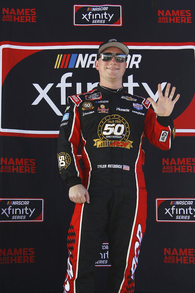 Tyler Reddick poses after winning the pole position for the NASCAR Xfinity Series auto racing championship at Homestead-Miami Speedway in Homestead, Fla. Saturday, Nov. 16, 2019. (AP Photo/Luis M. Alvarez)