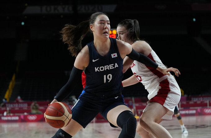 South Korea's Ji Su Park (19), front, drives around Canada's Bridget Carleton (6) during women's basketball preliminary round game at the 2020 Summer Olympics, Thursday, July 29, 2021, in Saitama, Japan. (AP Photo/Eric Gay)