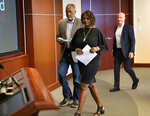Minneapolis residents Sondra Samuels, front, her husband, Don Samuels, left, and businessman Bruce Dachis, right, walk to the podium for the start of a press conference to discuss where the situation stands regarding language on the future of the Minneapolis policing ballot Wednesday, Sept. 15, 2021, in Minneapolis. A judge struck down ballot language last week that aimed to replace the Minneapolis Police Department with a new agency, which sent the City Council scrambling to approve new language that members hope will stand up. The injunction to keep the language off the ballot was sought by former City Council Member Samuels, his wife, and Dachis. (David Joles/Star Tribune via AP)