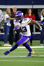 Minnesota Vikings running back Dalvin Cook (33) carries during the second half of the team's NFL football game against the Dallas Cowboys in Arlington, Texas, Sunday, Nov. 10, 2019. The Vikings won 28-24.  (AP Photo/Michael Ainsworth)
