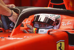 Ferrari driver Sebastian Vettel of Germany is handed the car's steering wheel in the team box during the first free practice session for the Austrian Formula One Grand Prix at the Red Bull Ring racetrack in Spielberg, southern Austria, Friday, June 28, 2019. The race will be held on Sunday. (AP Photo/Ronald Zak)