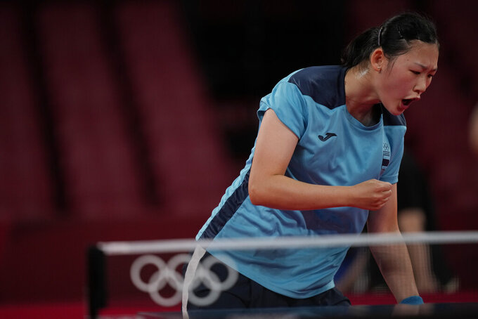 Spain's Maria Xiao reactss during the table tennis women's singles second round match against Hong Kong's Minnie Soo Wai-yam at the 2020 Summer Olympics, Sunday, July 25, 2021, in Tokyo. (AP Photo/Kin Cheung)
