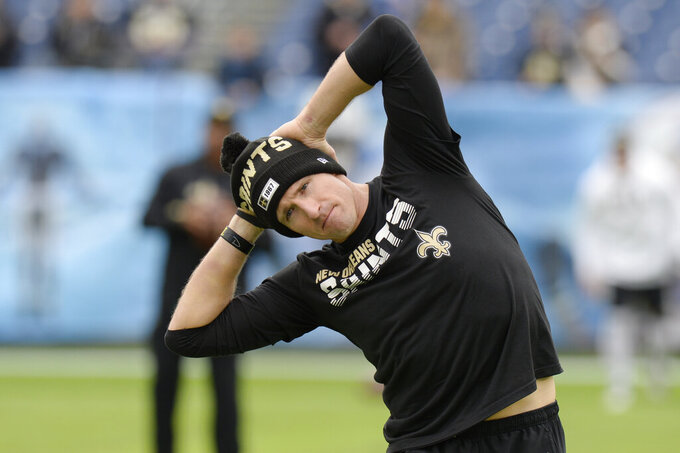 New Orleans Saints quarterback Drew Brees warms up before an NFL football game against the Tennessee Titans Sunday, Dec. 22, 2019, in Nashville, Tenn. (AP Photo/Mark Zaleski)