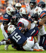 Auburn defensive back Jordyn Peters (15) stops Liberty running back Ceneca Espinoza, Jr. (6) during the first half of an NCAA college football game, Saturday, Nov. 17, 2018, in Auburn, Ala. (AP Photo/Vasha Hunt)