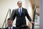 Sen. Patrick Toomey, R-Pa., leaves the U.S. Capitol building through the Senate Subway on Capitol Hill in Washington, Thursday, March 14, 2019, as the Senate rejects President Donald Trump's emergency border declaration. (AP Photo/Andrew Harnik)