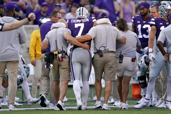 Kansas State quarterback Skylar Thompson (7) is helped off the field after being injured during the first half of an NCAA college football game against Southern Illinois, Saturday, Sept. 11, 2021, in Manhattan, Kan.(AP Photo/Charlie Riedel)