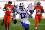 Buffalo Bills quarterback Josh Allen runs for a touchdown during the first half of an NFL football game against the Denver Broncos, Saturday, Dec. 19, 2020, in Denver. (AP Photo/Jack Dempsey)
