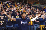 Murray State fans cheer for Memphis Grizzlies rookie Ja Morant, foreground, before the Grizzlies' NBA basketball game against the Cleveland Cavaliers on Friday, Jan. 17, 2020, in Memphis, Tenn. (AP Photo/Karen Pulfer Focht)