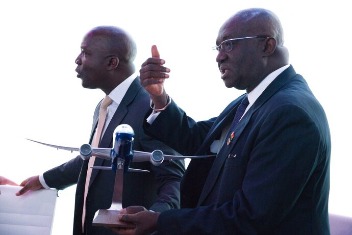 Ghana Aviation Minister Joseph Kofi Adda gestures while holding a model Boeing aircraft at a news conference at the Dubai Airshow in Dubai, United Arab Emirates, Tuesday, Nov. 19, 2019. Ghana said Tuesday that it will launch a national airline early next year with three new Boeing long-haul, widebody 787-9 Dreamliners. (AP Photo/Jon Gambrell)
