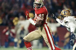 FILE - In this Nov. 7, 1989, file photo, San Francisco 49ers wide receiver Jerry Rice runs past New Orleans Saints' Toi Cook for a touchdown in the first half during the 49ers' 31-13 victory over the Saints at Candlestick Park in San Francisco. (AP Photo/Martha Jane Stanton, File)