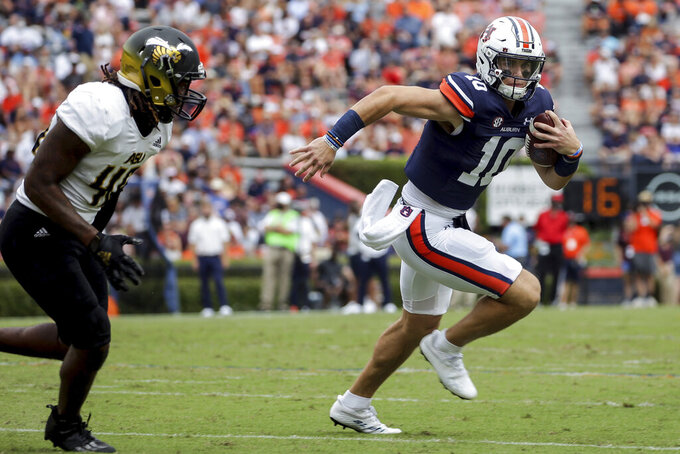 Auburn quarterback Bo Nix (10) carries the ball as Alabama State linebacker Jake Howard (46) pursues during the first half of an NCAA football game Saturday, Sept. 11, 2021, in Auburn, Ala. (AP Photo/Butch Dill)