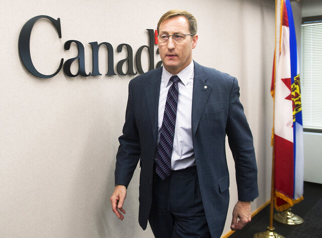 FILE - In this Feb. 14, 2015, file photo, Justice Minister Peter MacKay heads from a news conference in Halifax, Canada. Former Canadian Cabinet Minister MacKay criticized Canadian Prime Minister Justin Trudeau on Saturday, Jan. 25, 2020, as he officially announced he is running to be leader of Canada's Conservative Party. (Andrew Vaughan/The Canadian Press via AP, File)