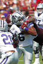 Kansas State running back Jordon Brown (6) fights through a Mississippi State tackle attempt for a 7-yard touchdown run during the first half of their NCAA college football game in Starkville, Miss., Saturday, Sept. 14, 2019. (AP Photo/Rogelio V. Solis)