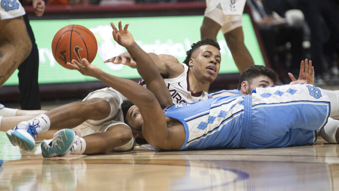 Virginia Tech guard Wabissa Bede,center battles North Carolina defenders Jeremiah Francis,left and Andrew Platek during the second half of an NCAA college basketball game in Blacksburg, Va., Wednesday, Jan. 22, 2020.(AP Photo/Lee Luther Jr.)