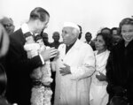 FILE - In this Jan. 21, 1959 file photo, India's Prime Minister Jawaharlal Nehru welcomes Britain's Prince Philip to New Delhi, India. The Prince is on the first stage of his round-the-world-tour and is scheduled to spend two weeks in India on the first stage of his 36,000-mile tour. Buckingham Palace says Prince Philip, husband of Queen Elizabeth II, has died aged 99. (AP Photo/File)