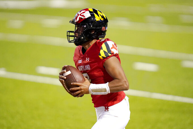 Maryland quarterback Taulia Tagovailoa runs for a touchdown against Minnesota during the first half of an NCAA college football game, Friday, Oct. 30, 2020, in College Park, Md. (AP Photo/Julio Cortez)